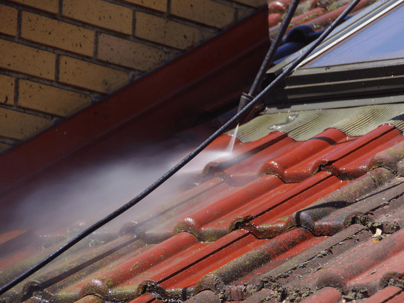 contractor uses the pressure wash to clean there residential roof